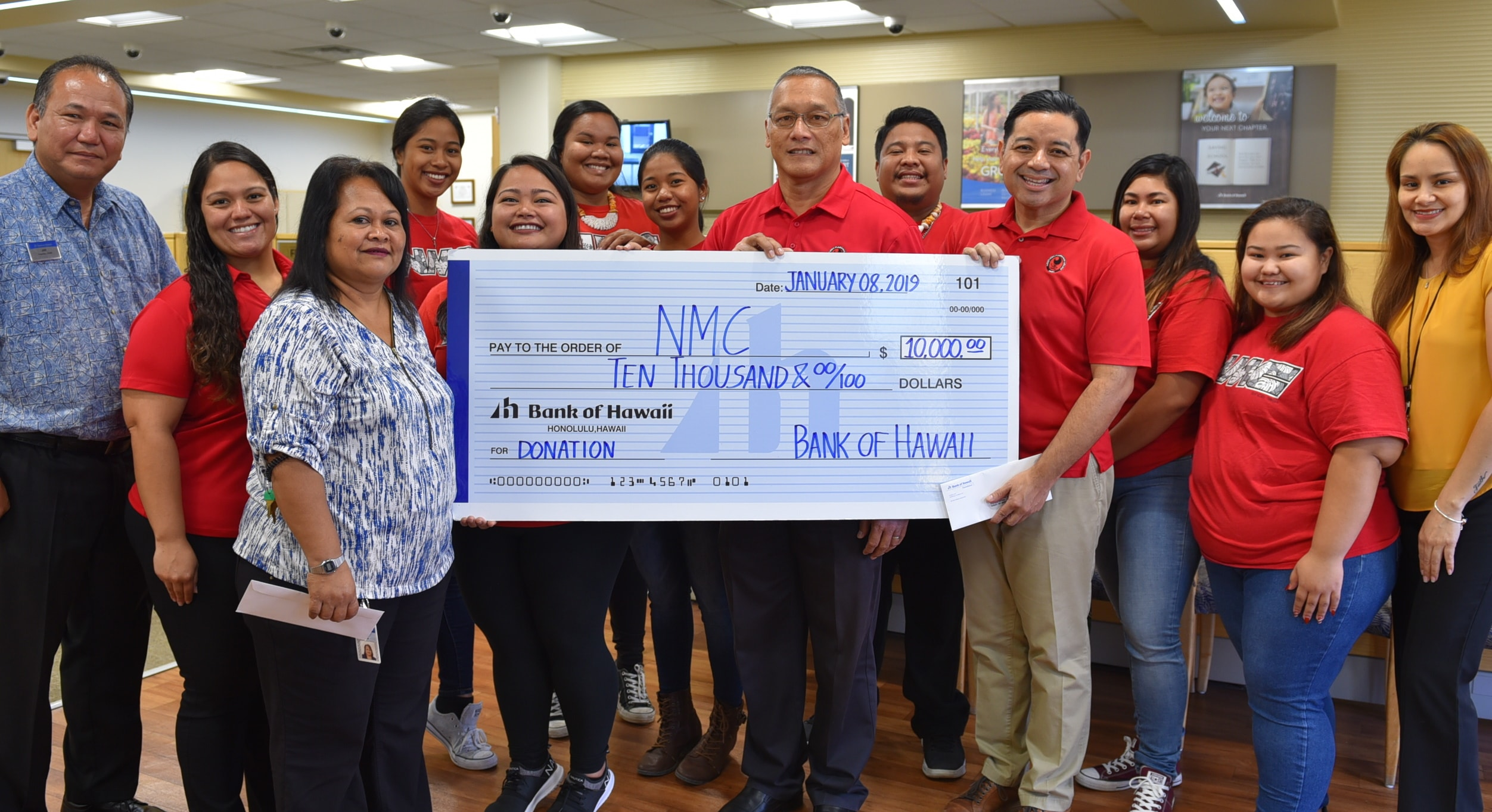 Bank of Hawaii donated $10,000 to Northern Marianas College. The donation check was presented by Rose Sumor, BOH Branch Manager (3rd from left), Joseph P. Fujihira, Officer & Assistant Branch Manager (1st from left), Joanne H. Aldan, Officer & Assistant Branch Manager (far right), and received by NMC BOR Chair, Charles Cepeda (center), NMC Interim President, Frankie Eliptico (4th from right), and students and staff of NMC.