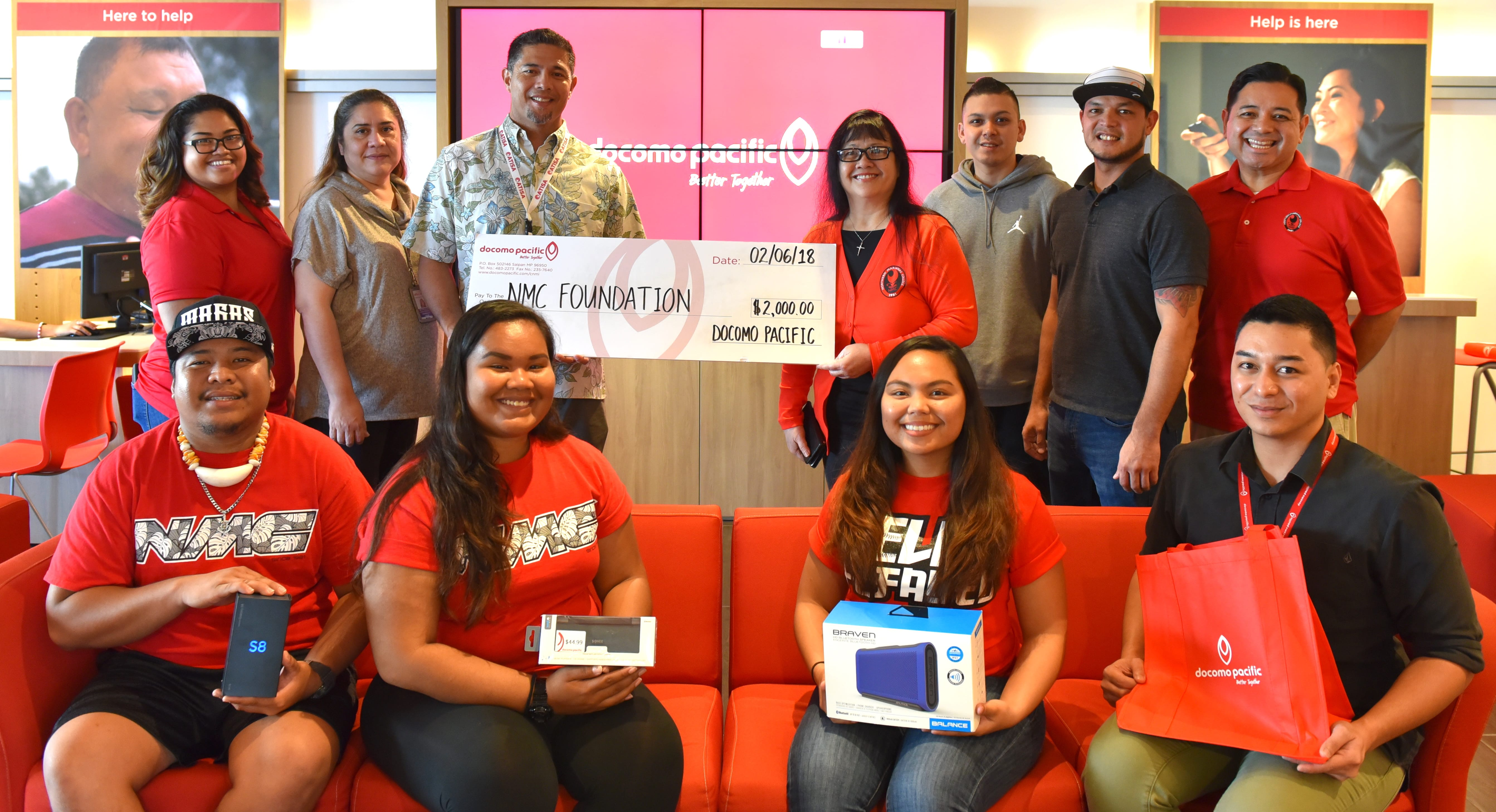 Docomo Pacific recently donated $3,000 in cash and prizes that will be featured at the upcoming annual NMC Foundation Golf Tournament on Saturday, March 3, 2018. In the photo are Docomo employees, led by Docomo Pacific Vice President Dino Manning (back row 3rd from left) and NMC staff and students, led by NMC President Dr. Carmen Fernandez (back row 4th from right).