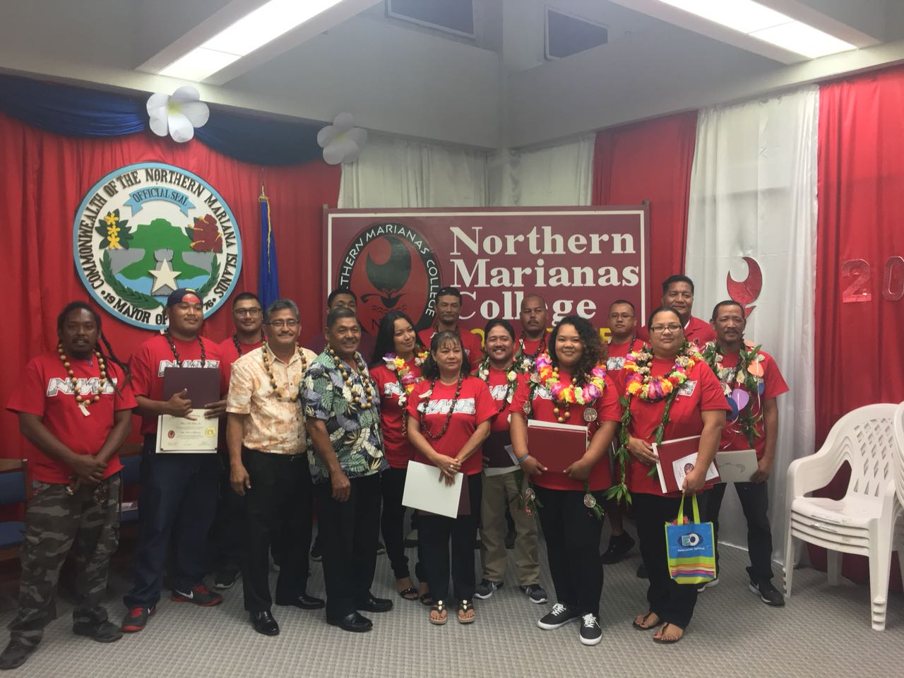 Graduates of the Adult Basic Education Program at Northern Marianas College in Rota pose for a group photo with CNMI Lt. Governor Victor Hocog (fifth from left) and Rota Mayor Efraim Atalig (fourth from left). This is the second cohort of graduates that completed the Adult Basic Education program since the program was reintroduced one year ago. Also in the photo is Martin Mendiola, NMC Rota Center Executive Director.